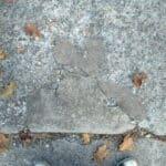 grinding concrete sidewalk